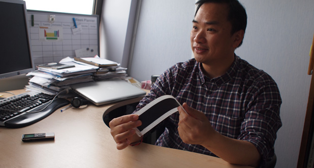 Dr. Tong shows flexible solar panels